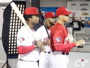 Sterling Guzman and Jesus Navarro wield the bats behind pitcher Justin Watts.